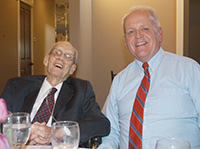 David O. Moore (left) shares a laugh with his friend Steve Hemphill during the Cooperative Baptist Fellowship Heartland Celebration of Excellence April 21. Moore, a longtime William Jewell College Bible professor and religion department chair, died  Oct. 28. Hemphill eulogized Moore during the memorial.