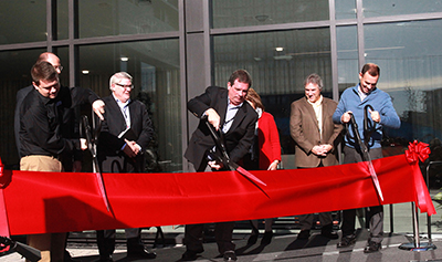 LifeWay President and CEO Thom S. Rainer (center) is joined by Carlton Capps, manager of the Nashville LifeWay Store (left), Eric Geiger, LifeWay senior vice president and CBO (right) and members of the executive leadership team in cutting the ribbon to celebrate the grand opening of the SBC entity's new corporate headquarters and LifeWay Store in downtown Nashville. (Katie Shull/LifeWay)