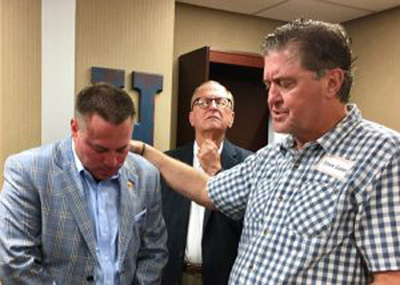 Tennessee pastor Steve Gaines, president of the Southern Baptist Convention (right) prays for Butch Jones, head coach at the University of Tennessee, during a faith and football night at Second Baptist Church in Union City. A separate outreach event featured former Tennessee head football coach Phillip Fulmer.