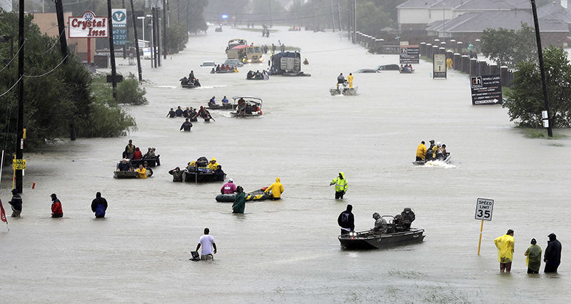 Rescue boats fill a flooded street as people are evacuated as floodwaters from Tropical Storm Harvey rise on Aug. 28, 2017, in Houston. (AP Photo/David J. Phillip)