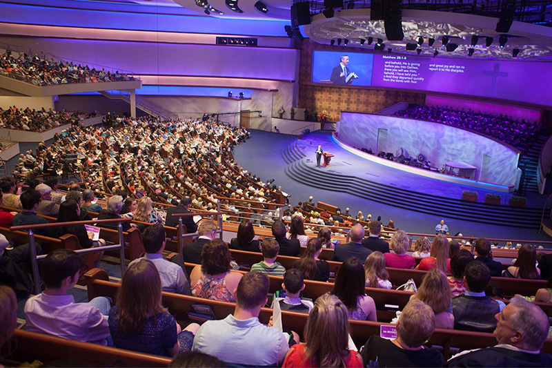 Pastor Robert Jeffress preaches to a large congregation in the 3,000-seat sanctuary at First Baptist Dallas. Photo by Luke Edmonson, courtesy of First Baptist Dallas