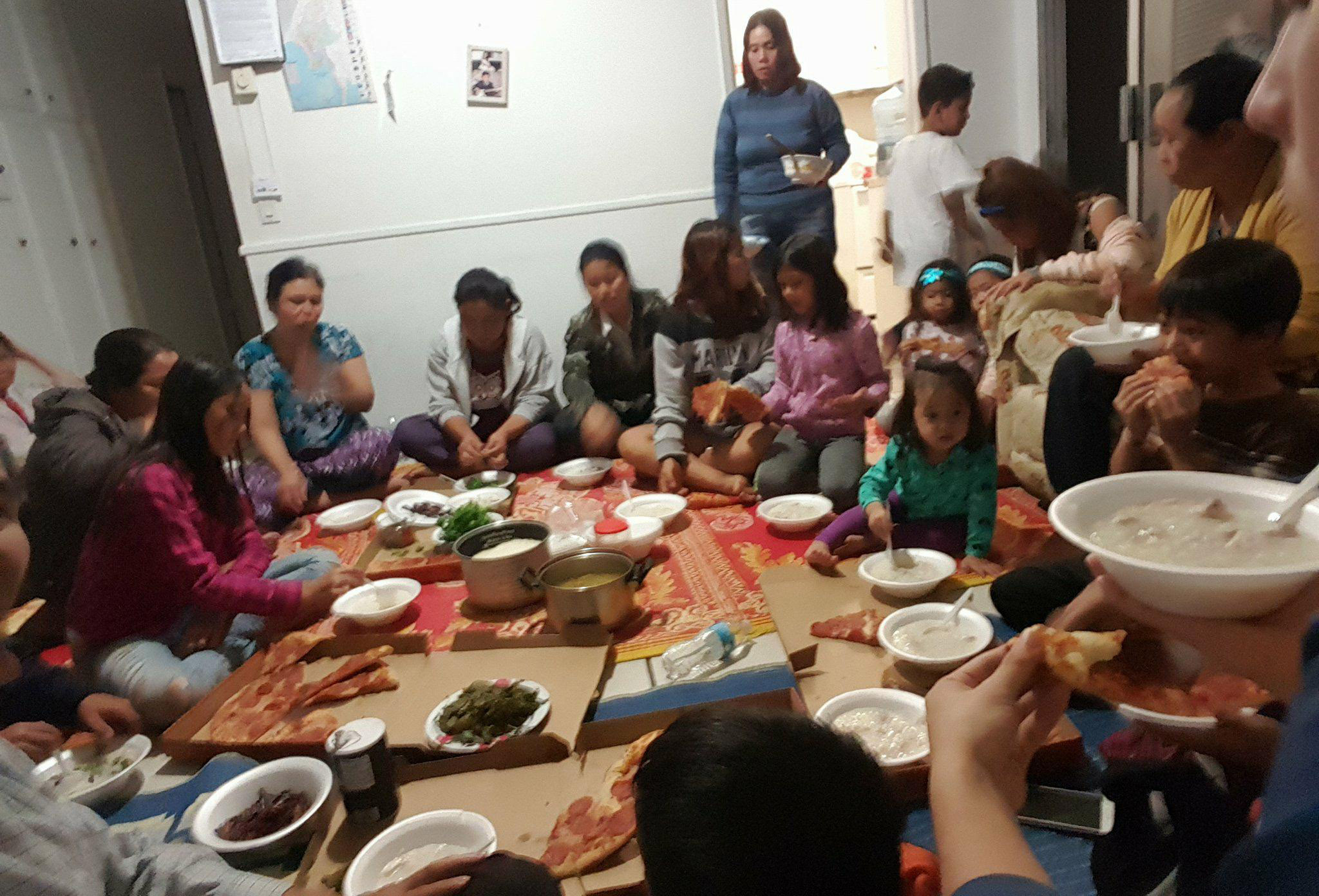 Members of Agape Myanmar Mission share a Burmese meal after their Sunday worship in San Diego's City Heights neighborhood. (Submitted photo)