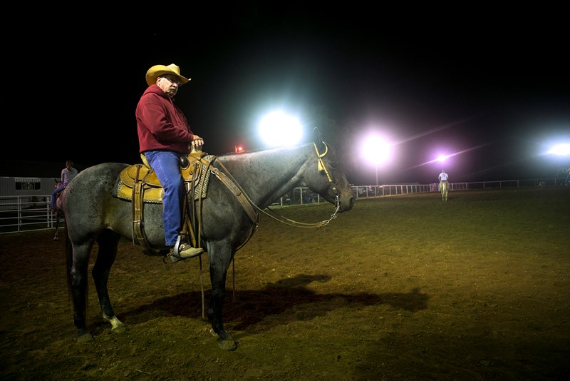 From his perch, bivocational pastor Don Mayberry keeps watch at Three Wooden Crosses cowboy church's lighted arena in rural Kansas. On the back of his horse is his favorite place to preach. (Photo: Sue Sprenkle)